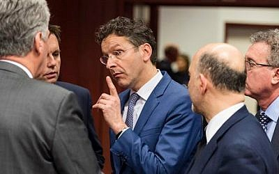 Dutch Finance Minister Jeroen Dijsselbloem, center, speaks with Austrian Finance Minister Hans Jorg Schelling, left, during a round table meeting of eurogroup finance ministers in Brussels on Friday, February 20, 2015 (photo credit: AP/Geert Vanden Wijngaert)