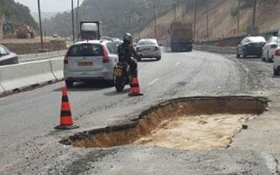A pothole on Highway 1, March 18 2014 (Photo credit: Courtesy)