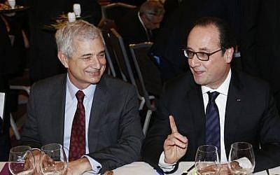 French President Francois Hollande, right, attends the 30th annual dinner held by the French Jewish Institutions Representative Council (Conseil Representatif des Institutions juives de France, CRIF) next to French Parliament President Claude Bartolone, left, in Paris, France, Monday, Feb. 23, 2015. (photo credit: AP Photo/Etienne Laurent, pool)