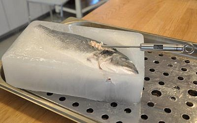 A digital thermometer displays an internal temperature of 74 degrees Celsius in this salmon, which was cooked inside a block of ice in a Goji oven (Photo credit: Courtesy)