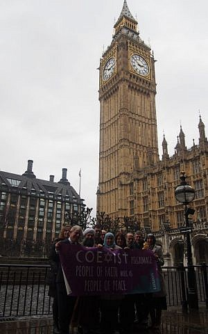 Marchers on London's Coexist Pilgrimage in front of Big Ben, February 19, 2015. (credit Richard Verber/ World Jewish Relief)