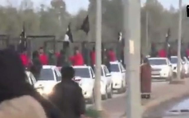 Kurdish fighters paraded in cages by the Islamic State group in a recent video. (screen capture: YouTube)