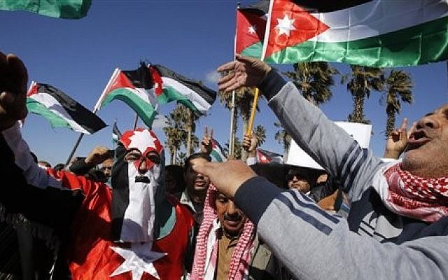 Jordanians chant slogans to show their support for the government against terror as they were waiting for Jordan's King Abdullah II, returning from the US, at Queen Alia Airport in Amman, Jordan, Wednesday, Feb. 4, 2015. (AP Photo/Raad Adayleh)