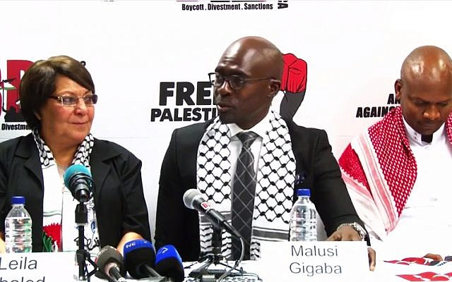 PFLP terrorist hijacker Leila Khaled, left, with ANC officials in South Africa on February 6, 2015. (screen capture: YouTube/BDS South Africa)
