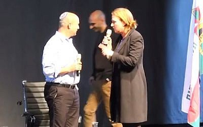 Jewish Home leader Naftali Bennett and Hatnua head Tzipi Livni, of the Zionist Camp, spar over giving up land for peace in this screen grab from a video uploaded February 1, 2015 . (Photo credit: screenshot/YouTube)
