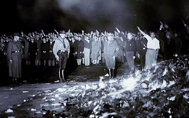 Nazi book-burning incident during the 1930s. (screen capture: YouTube/United States Holocaust Memorial Museum)