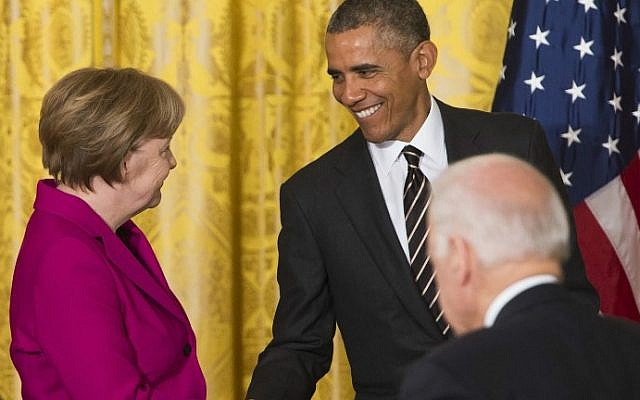 US President Barack Obama and German Chancellor Angela Merkel shake hands following a joint press conference at the White House in Washington, DC, February 9, 2015. (photo credit: AFP/Saul Loeb)