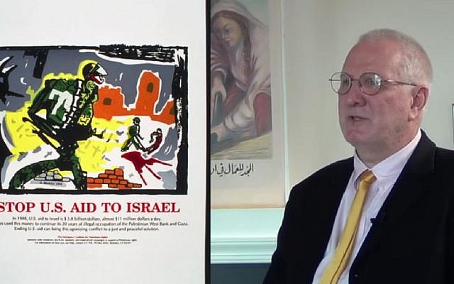 Dan Walsh, the owner and curator of the Palestine Poster Project Archives, which was nominated for inclusion into the UNESCO International Memory of the World Register, but blocked by the UNESCO director general, with one of the posters (screen capture: YouTube)