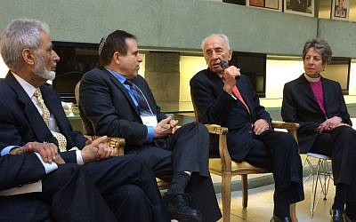 Former Israeli president Shimon Peres (with microphone) meeting in Tel Aviv with (from left) Sayyid Syeed, of the Islamic Society of North America; Rabbi Steve Gutow, of the Jewish Council for Public Affairs; and Katharine Jefferts Schori, presiding bishop of the Episcopal Church of the United States, on January 20, 2015. (photo credit: JCPA/via JTA)