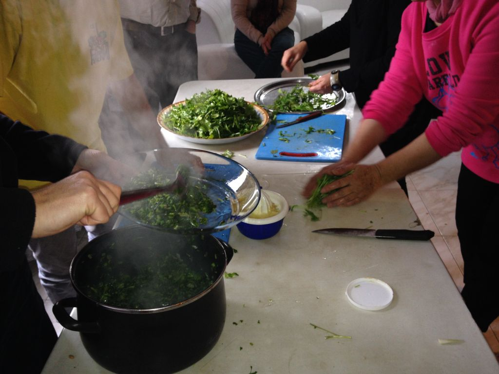Steam rises from the freshly cooked chubeza leaves (photo credit: Jessica Steinberg/Times of Israel)