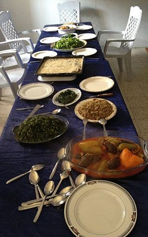 A table laden with Nazira Madi's homemade feast (photo credit: Jessica Steinberg/Times of Israel)