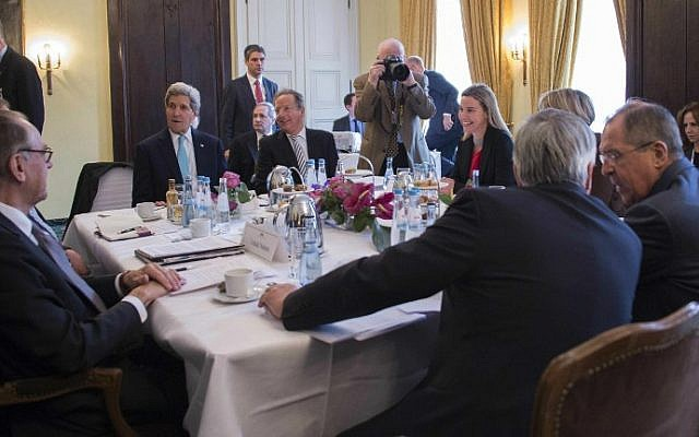 US Secretary of State John Kerry (second from the left) talks during a meeting with Russian Foreign Minister Sergey Lavrov (right) and other members of the the Quartet on the Middle East on the third day of the 51st Munich Security Conference (MSC) in Munich, southern Germany, on February 8, 2015. (photo credit: AFP/Pool/ Jim Watson)