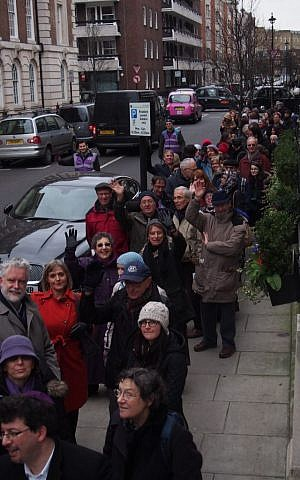 Marchers in London's Coexist Pilgrimage line up to enter Central Synagogue Portland Place, February 19, 2015. (credit Richard Verber/World Jewish Relief)