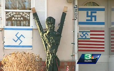 A house in Sacramento 'decorated' with swastikas (screen capture: KCRA)