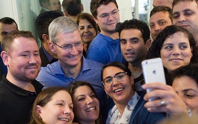 Apple CEO Tim Cook poses for a selfie with Apple's Herzliya employees, February 26, 2015. (photo credit: Courtesy)