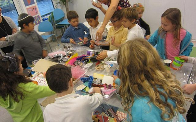 Shefa students working on an art project in which they make self-portrait collages. (The Shefa School/via JTA)
