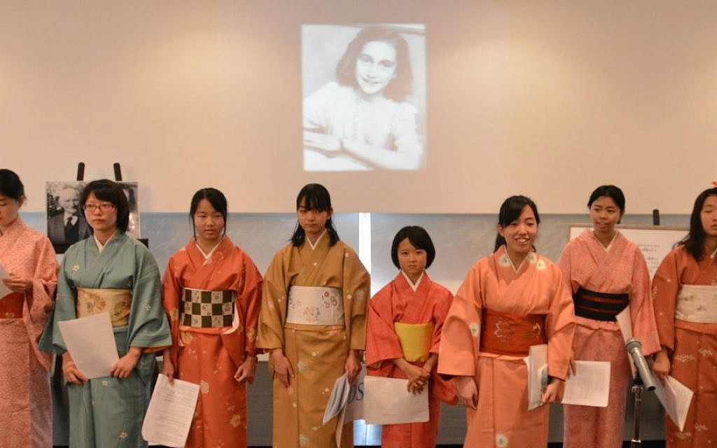 Members of the Small Hands choir of the Beit Shalom congregation speaking about Anne Frank at the Holocaust Education Center in Fukuyama, Japan, December 27, 2014. (photo credit: Cnaan Liphshiz/JTA)
