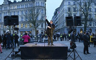Swedish Prime Minister Stefan Loefven delivers a speechas people gather to form a 'ring of peace' around the big synagogue at Raoul Wallenbergs place in central Stockholm, on February 27, 2015. (photo credit: AFP/TT News Agency/ Henrik Montgomery)