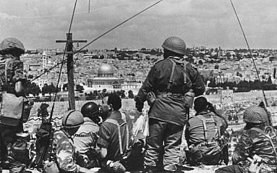 IDF soldiers survey the Old City before launching their attack, June 1967 (photo credit: Wikimedia Commons CC BY-SA/Mazel123)
