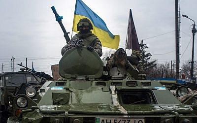 Ukrainian soldiers ride armored vehicles to Debaltseve, eastern Ukraine, Donetsk region, on February 1, 2015. (AFP/Oleksander Stashevsky)