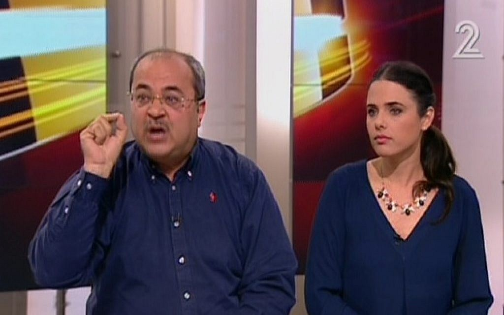 Ahmed Tibi (Joint Arab List) and Ayelet Shaked (Jewish Home) interviewed on Channel 2 on February 9, 2015. (photo credit: Screen capture, Channel 2)