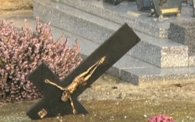 Graves desecrated in Tracy-sur-Mer, France on February 18, 2015. (screen capture: NBC News)