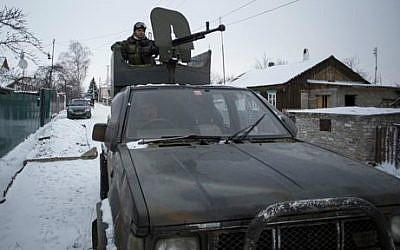 A pro-Russian rebel mans a weapon mounted on a pickup truck in the town of Vuhlehirsk, eastern Ukraine, Tuesday, February 10, 2015 (photo credit: AP /Vadim Braydov)