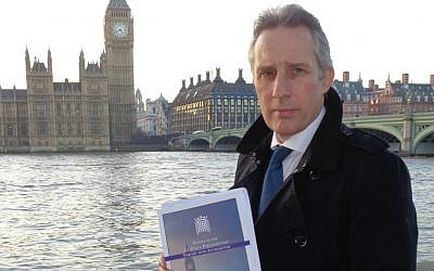 Democratic Unionist Party MP Ian Paisley holds a copy of the 2015 All Party Parliamentary Report on Antisemitism. (courtesy)