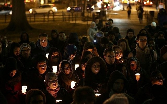 Supporters of the Council on American-Islamic Relations hold a vigil in Dupont Circle, Washington, DC, on February 12, 2015. (photo credit: AFP/Win McNamee/Getty Images)