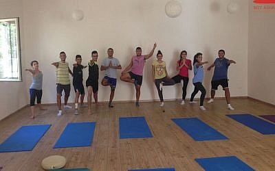 At Beit Ashams, yoga practitioners in warrior and tree poses. (photo credit: Courtesy of Beit Ashams/shams.ps/JTA)