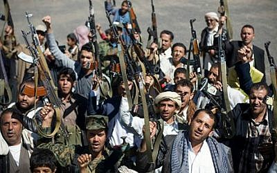 Houthi Shiite Yemenis hold their weapons during a rally to show support for their comrades in Sanaa, Yemen, Wednesday, February 4, 2015 (photo credit: AP/Hani Mohammed)