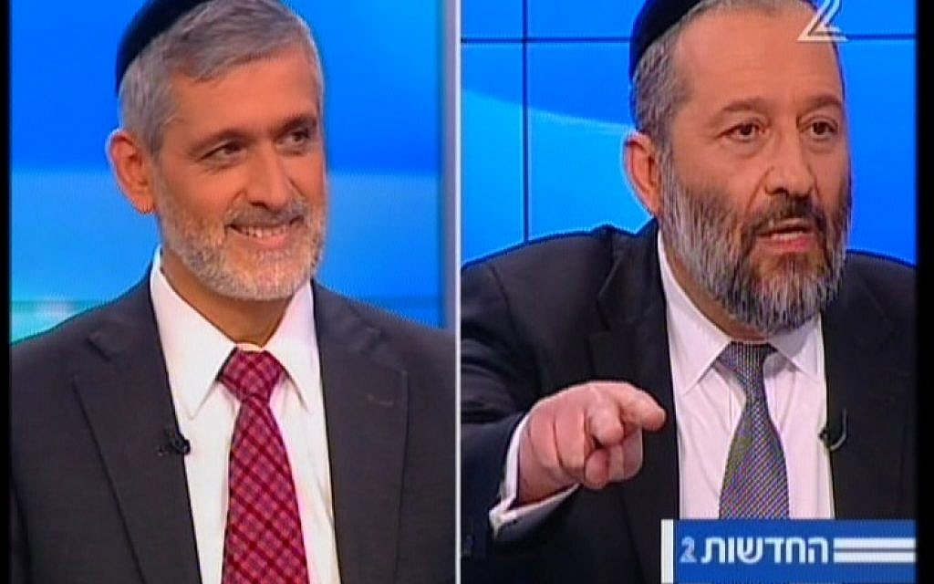 Eli Yishai, left, and Aryeh Deri arguing during a televised debate on February 26, 2015. (Screen capture: Channel 2)