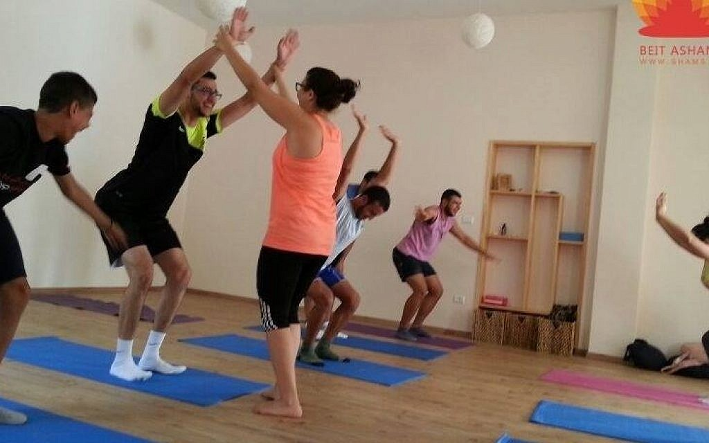 Yoga practitioners at Beit Ashams in Beit Jala practicing the chair pose. (photo credit: JTA/Courtesy of Beit Ashams/shams.ps)