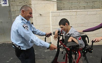 Police officers from Jerusalem's Lev Habira station have been training ALEH residents for the Jerusalem Marathon for months. (Courtesy of ALEH Jerusalem)