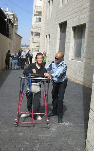 Police officers and ALEH residents train for the Jerusalem Marathon on a path outside the ALEH facility in Romema, Jerusalem. (Courtesy of ALEH Jerusalem)