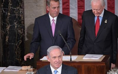 Prime Minister Benjamin Netanyahu addresses a joint session of the US Congress on March 3, 2015 at the US Capitol in Washington. Looking on are House Speaker John Boehner (left) and President pro tempore of the Senate Sen. Orrin Hatch. (photo credit: Mandel Ngan/AFP)
