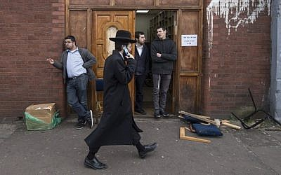 Illustrative photo of an Orthodox Jew walking past the Ahavas Torah Synagogue in the Stamford Hill area of north London on March 22, 2015. (AFP/Niklas Halle'n)