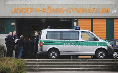Police officers at the Joseph-Koenig secondary school in Haltern am See, western Germany on March 24, 2015. A group of 16 school children and 2 teachers from this school are believed to have been on board the crashed Germanwings airplane. (photo credit: Marcel Kusch/AFP/DPA)