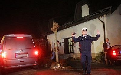 Investigators leave the house of the parents of Andreas Lubitz, the co-pilot of the crashed Germanwings on March 26, 2015, in Montabaur, soutwestern Germany (Photo credit: AFP/ DPA / Fredrik Von Erichsen)