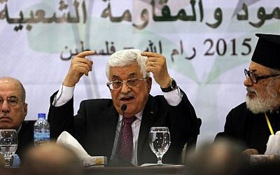 PA President Mahmoud Abbas addresses the Palestinian leadership at the opening of a two-day conference in the West Bank city of Ramallah to discuss the future of the Palestinian Authority, on March 4, 2015. (Photo credit: AFP/ABBAS MOMANI)