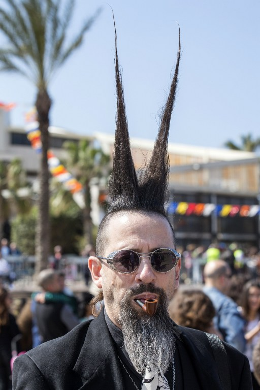 A dressed up Israeli takes part in a parade during the festivities of the Jewish Purim festival on March 5, 2015 in the central Israeli city of Netanya. (photo credit: AFP PHOTO / JACK GUEZ)