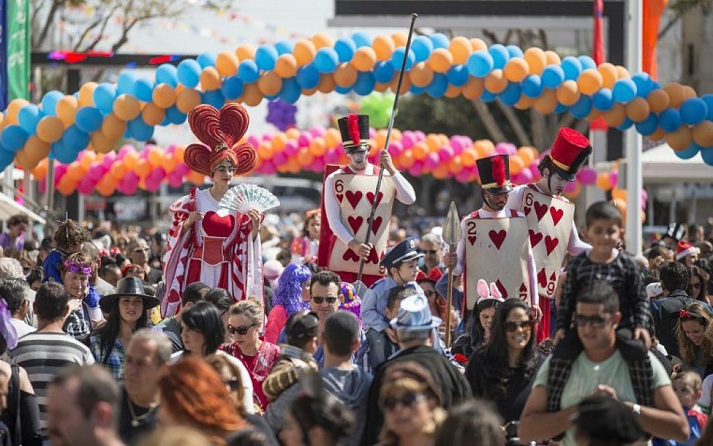 Dressed-up Israelis take part in a parade during the festivities of the Jewish Purim festival on March 5, 2015, in the central Israeli city of Netanya. (photo credit: AFP PHOTO/Jack Guez)