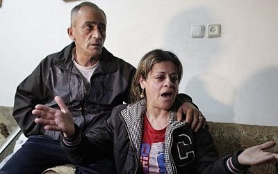 The parents of Arab-Israeli Muhammad Musallam react at the family's home in the Beit Hanina neighborhood of East Jerusalem on March 10, 2015, after the Islamic State (IS) released a video purportedly showing a young boy executing their son. (photo credit: AFP / AHMAD GHARABLI)