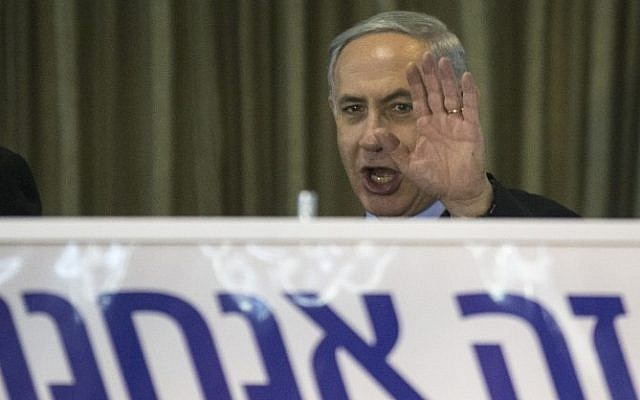 Prime Minister Benjamin Netanyahu, gestures during an election campaign meeting with his supporters in the city of Netanya on March 11, 2015 (photo credit: AFP/JACK GUEZ)