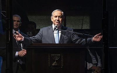 Prime Minister Benjamin Netanyahu speaks during a campaign rally in Rabin Square, Tel Aviv, on March 15, 2015. (photo credit: AFP/Jack Guez)