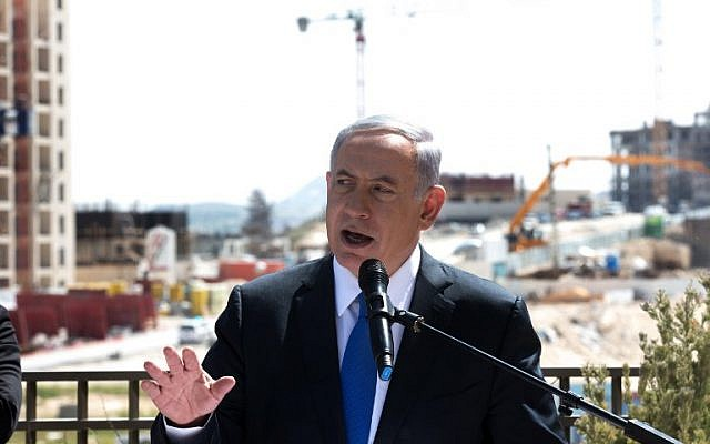 Prime Minister Benjamin Netanyahu gives a statement to the press during his visit in Har Homa, on March 16, 2015. (Menahem Kahana/AFP))