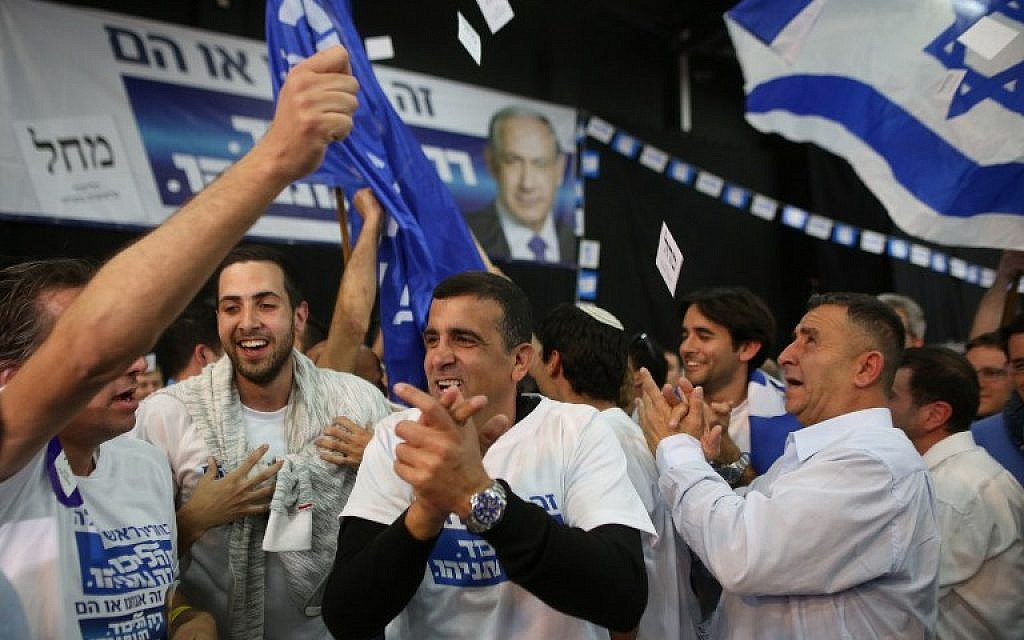 Likud party supporters react to exit polls while they wait at the party's headquarters in Tel Aviv for the announcement of the official results of the Knesset elections on March 17, 2015. (AFP/Menahem Kahana)
