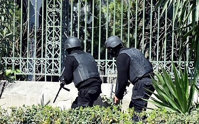 Illustrative: Tunisian security forces secure the area after gunmen attacked Tunis' famed Bardo Museum on March 18, 2015. (photo credit: AFP/ FETHI BELAID)