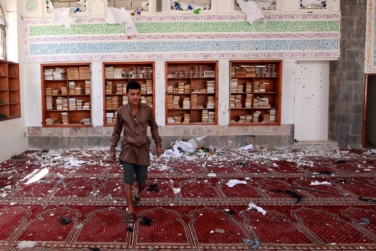 A Yemeni man inspects the damage following a bomb explosion at the Badr mosque in southern Sanaa on March 20, 2015. (photo credit: AFP/MOHAMMED HUWAIS)