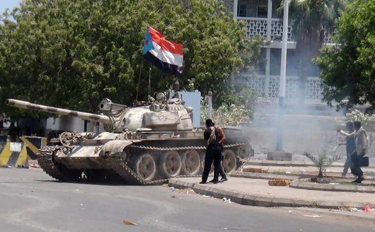 A tank bearing the flag of southern separatist movement, which was confiscated from a military depot, is driven on a street in the southern Yemeni city of Aden on March 27, 2015. (photo credit: AFP/SALEH AL-OBEIDI)